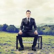 Businessman waiting sitting on a bench — Stock fotografie