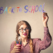 "Young student writing ""back to school"" — Stock Photo"