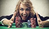 Woman playing poker — Stock Photo