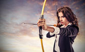Business woman aiming — Stock Photo