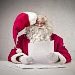 Father Christmas reading — Stock Photo