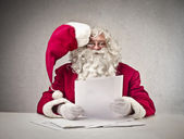 Father Christmas reading — Stock Photo