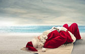 Father Christmas relaxing — Stock Photo