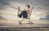 Businessman into a cart — Stock Photo