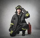Fireman putting on his helmet — Stock Photo