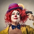 Clown ready to shoot herself — Stock Photo