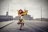 Clown dancing in the middle of the street — Stock Photo