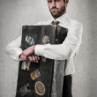 Businessman holding a suitcase — Stock Photo