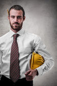 Businessman holding a working hat — Stock Photo