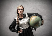Smiling young student holding a globe — Stock Photo