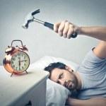 Man about to crash the alarm clock — Stock Photo