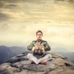Man meditating — Stock Photo #34896075