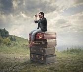 Man looking through a binoculars — Stock Photo