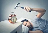 Man about to crash the alarm clock — Zdjęcie stockowe