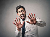 Scared businessman screaming — Stock Photo