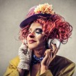 Clown listening to some music — Stock Photo