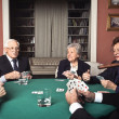 Old men and women playing poker — Stock Photo #38583309