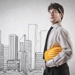 Businessman building a city — Stock Photo