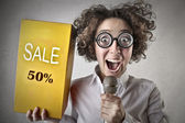 Woman promoting the sale — Stock Photo