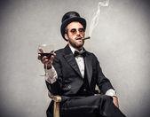 Rich man smoking a cigar — Stock Photo