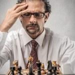 Man playing chess — Stock Photo