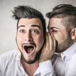 Man telling a secret to his friend — Stock Photo