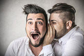 Man telling a secret to his friend — Stock Photo
