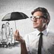 Stock Photo: Businessman holding an umbrella