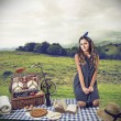 Stock Photo: Young woman having a pic nic