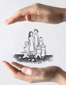 Hands protecting a family — 图库照片