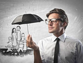 Zakenman houden een paraplu — Stockfoto