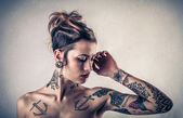 Beautiful alternative woman with tatoos — Stock Photo