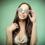 Beautiful young woman wearing glasses — Stock Photo