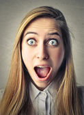 Astonished screaming woman — Stock Photo