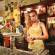 Young woman making a beer — Stock Photo #43900021