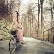 Young woman riding a bike — Stock Photo #43901655
