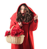 Woman dressed up as little red riding hood — Stock Photo