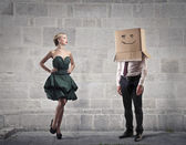 Businessman's head into a box with a beautiful young woman — Stock Photo