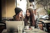 Young beautiful women chatting — Stock Photo