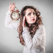 Woman holding an alarm clock — Stock Photo