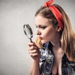 Pin-up woman with a hand lens — Stock Photo #43958833