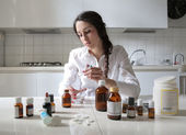 Young woman taking some medicines — Foto de Stock