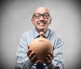 Businessman with a moneybox — Stock Photo