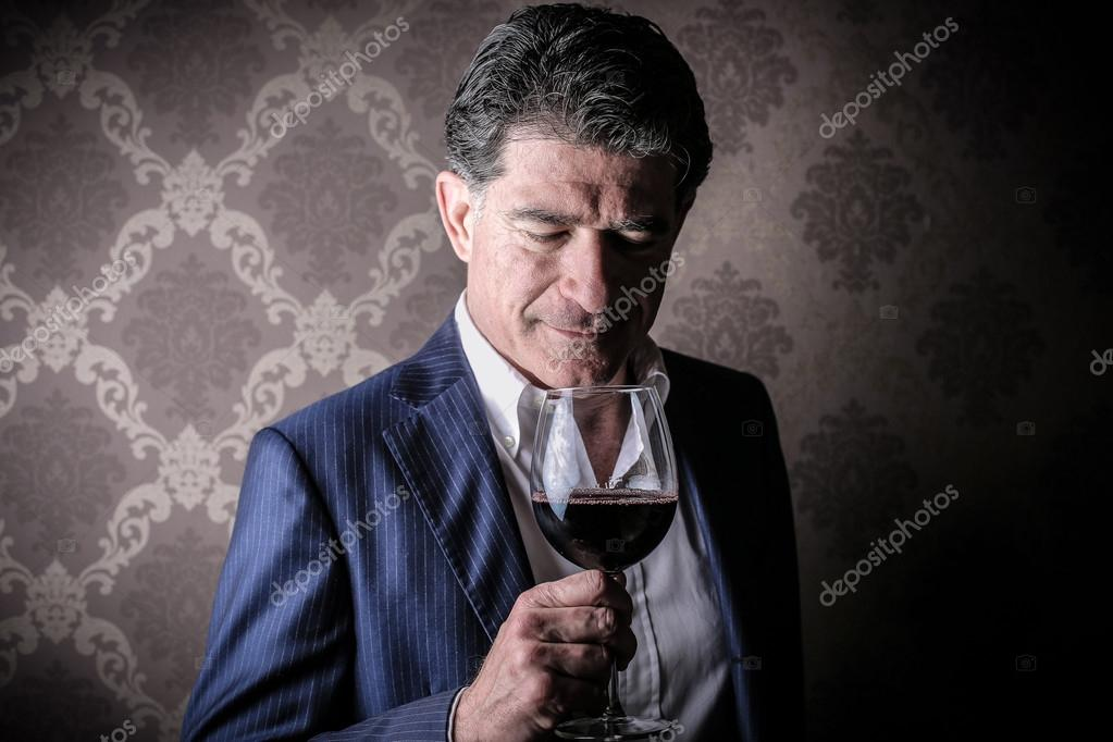 depositphotos_43988867-Elegant-rich-man-with-a-glass-of-wine.jpg