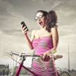Astonished surpries woman looking at her mobile phone — Stock Photo