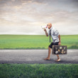 Poor businessman walking with his suitcase — Stock Photo