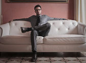 Businessman sitting on the sofa — Foto Stock