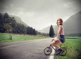 Young woman on a small bike — Stock Photo