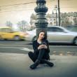 Young beautiful woman smiling looking at her mobile phone — Stock Photo #44000159