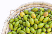 Argan nuts in basket. — Stock Photo
